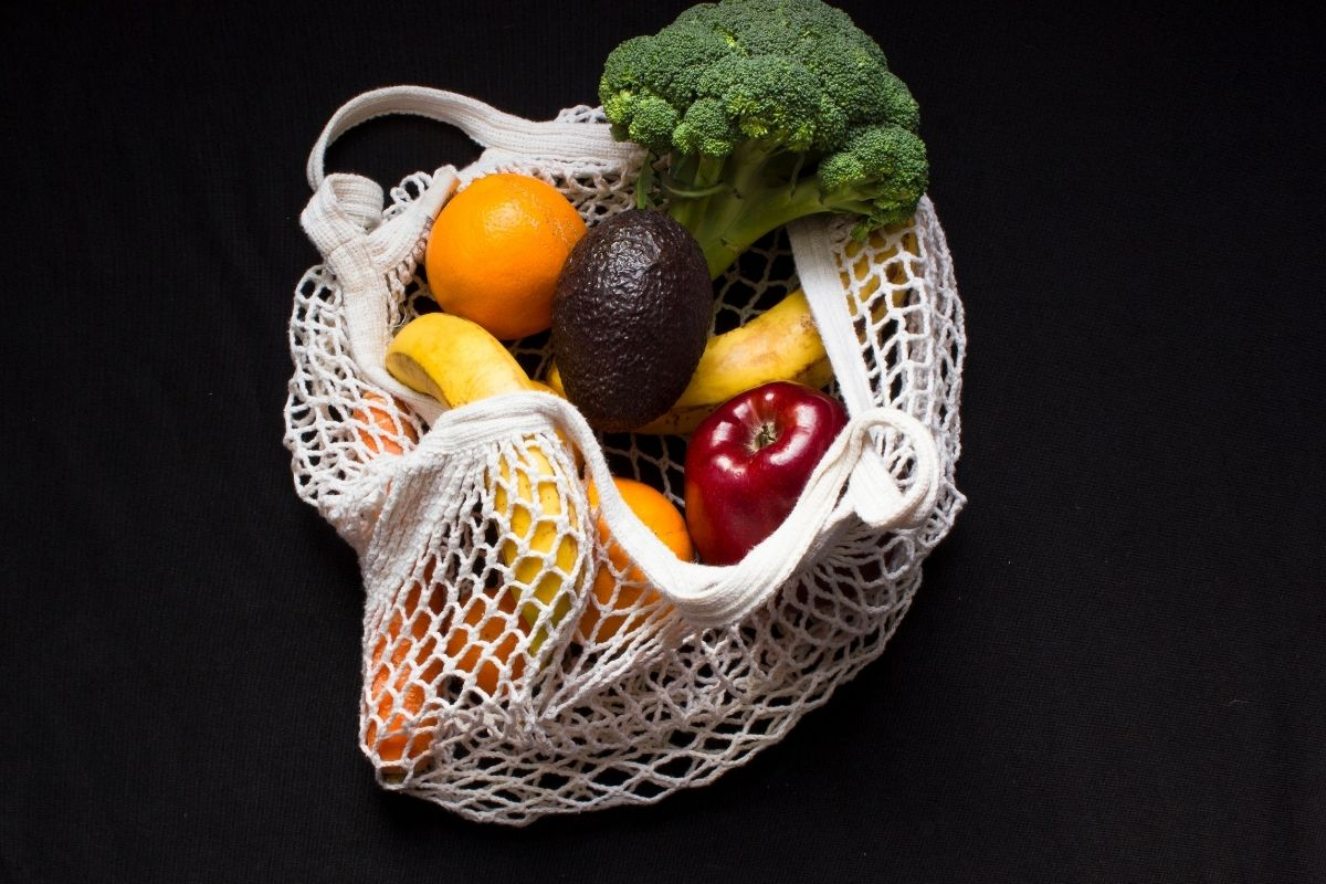 a netted bag holding produce to illustrate the purpose of gluten in bread.