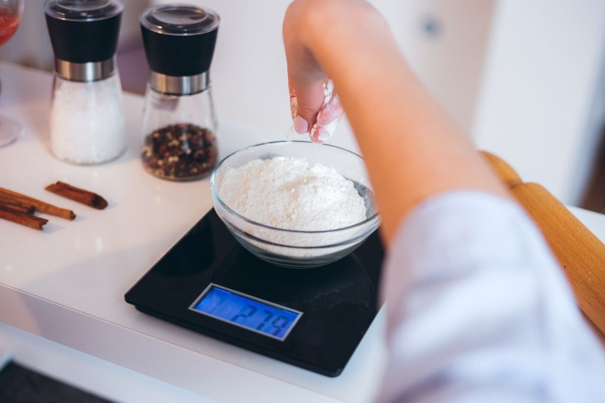 weighing flour with a digital scales