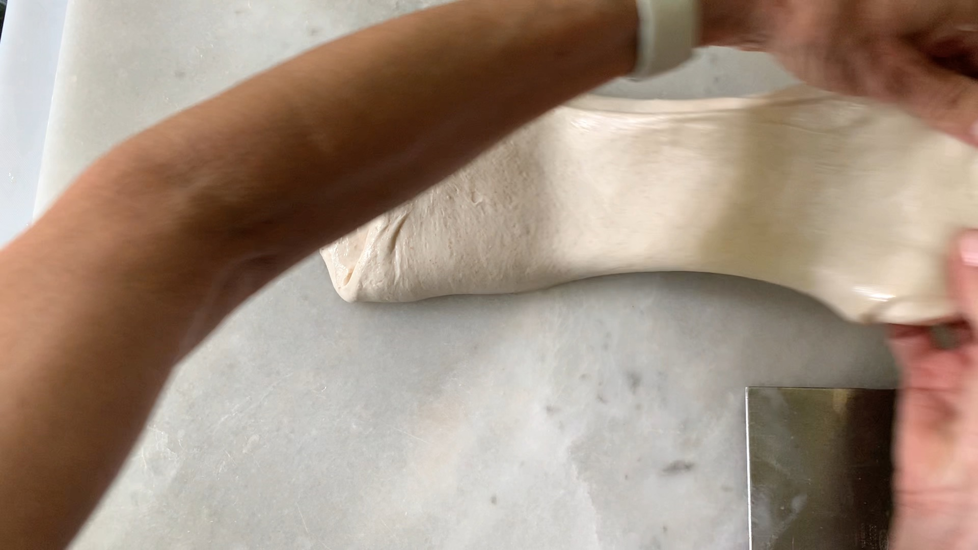 stretching and folding the dough to build structure.