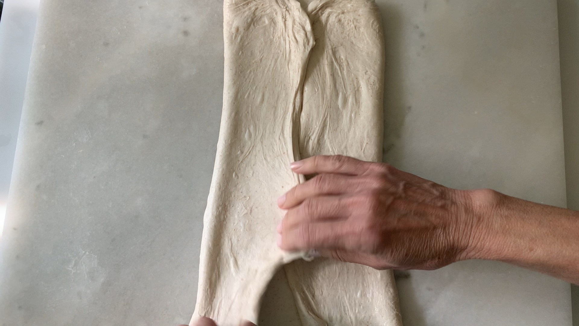 forming the dough after stretching it into a large square.