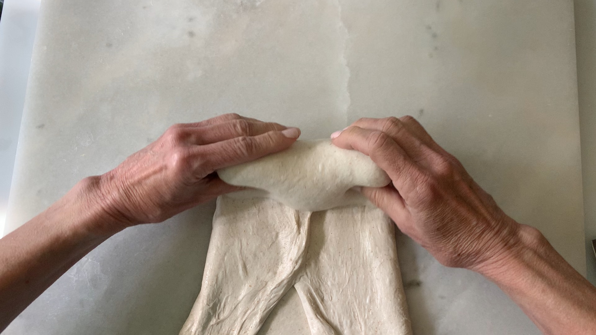 rolling dough into a batard.