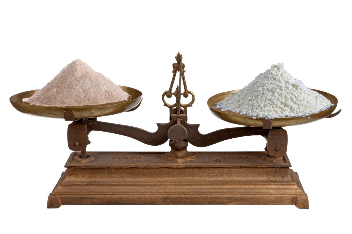 scales illustrating ratio of whole wheat flour to white bread flour in a recipe