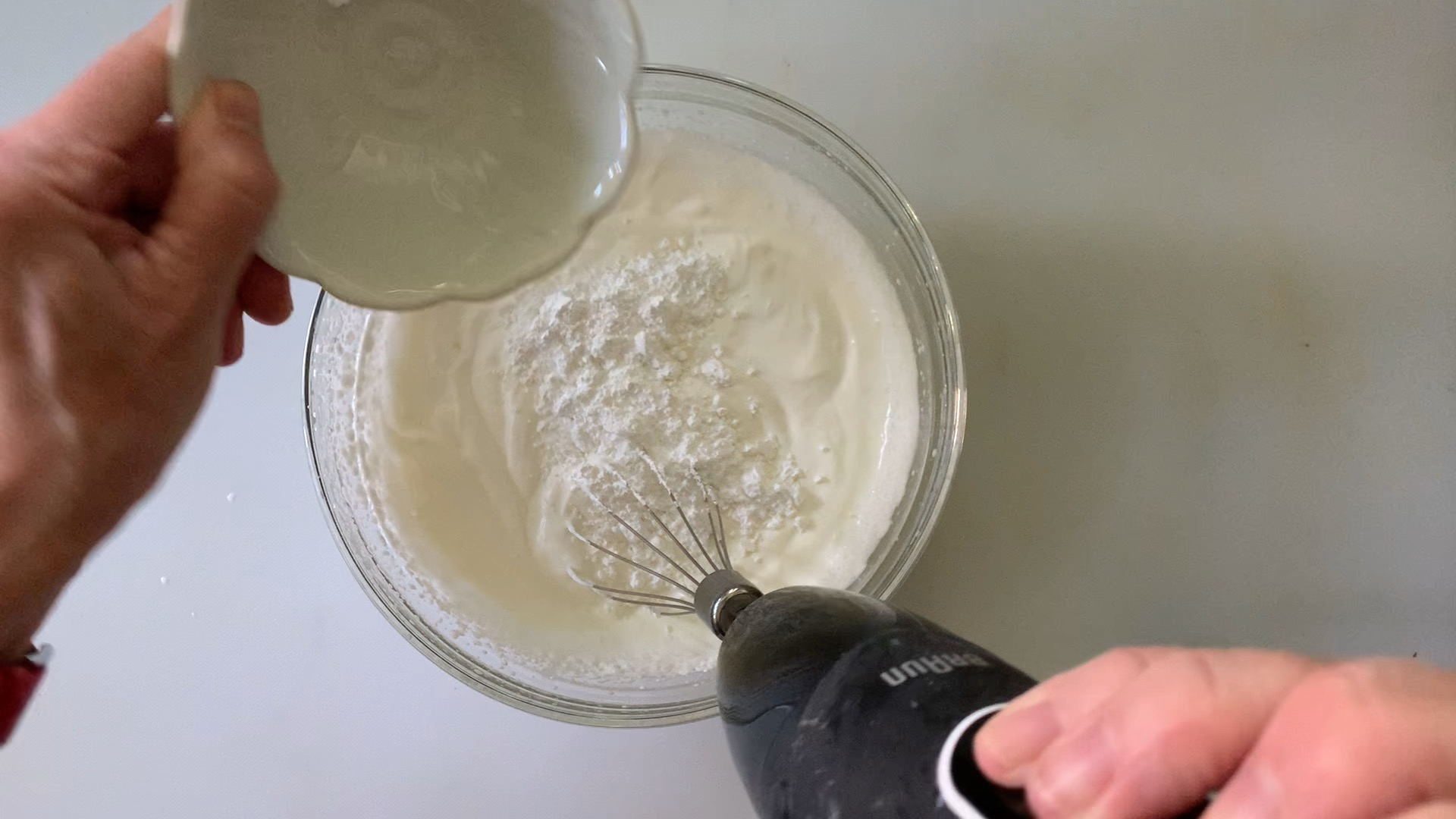 Adding powdered sugar and vanilla extract to whipped topping