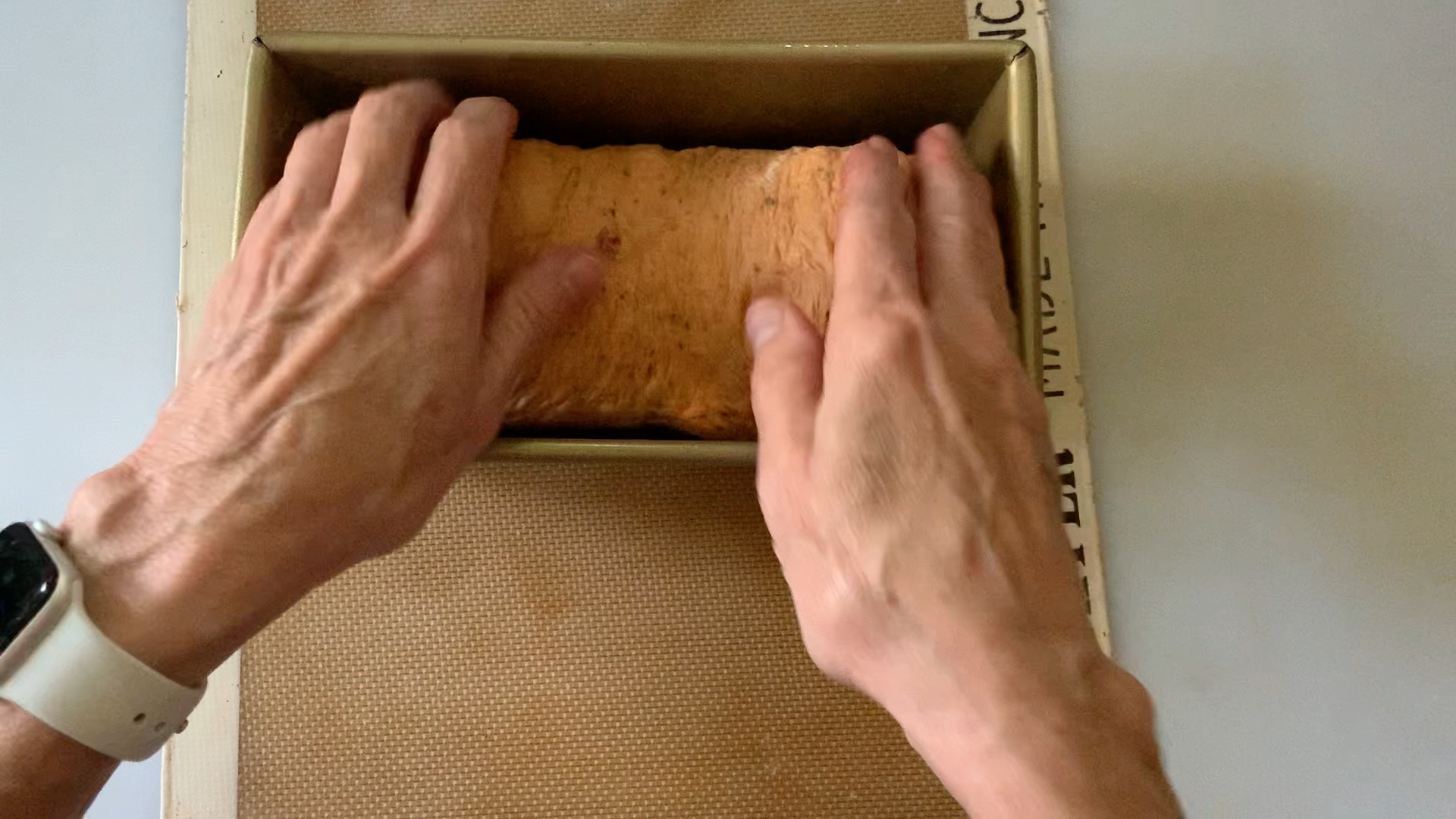 laying dough into a loaf pan