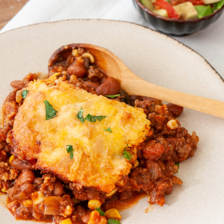 a serving of tamale pie with a cornmeal topping